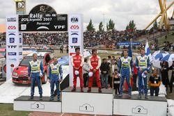 Podium: winners Sébastien Loeb and Daniel Elena, second place Marcus Gronholm and Timo Rautianen, th