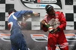 Podium: champagne for Raphael Matos and Carl Skerlong