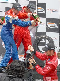 Podium: champagne for Carl Skerlong, Raphael Matos and James Hinchcliffe