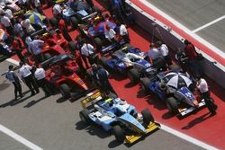 GP2 teams wait in the holding area for practice to start