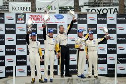 GT1 podium: class winners Oliver Gavin and Olivier Beretta, second place Johnny O'Connell and Jan Ma