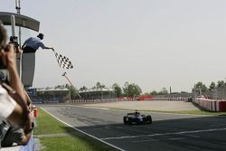Timo Glock crosses the line to take victory