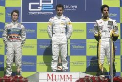 Timo Glock on the podium with Javier Villa and Lucas di Grassi