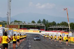 The Safety Car drives through the grid girls