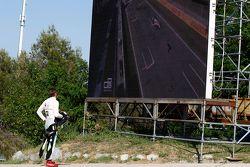 Seb Morris, Status Grand Prix, watches the big screen tv