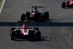 Esteban Ocon, ART Grand Prix leads Luca Ghiotto, Trident