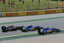 Felipe Nasr, Sauber C34 leads Marcus Ericsson, Sauber C34 and Jenson Button, McLaren MP4-30 at the start of the race