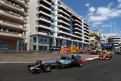 Nico Rosberg, Mercedes AMG F1 W06 leads Sebastian Vettel, Ferrari