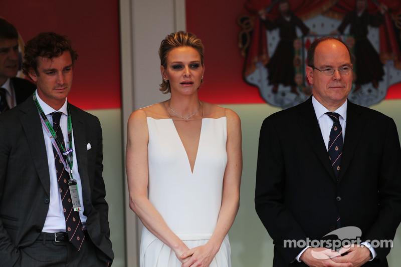 HSH Prince Albert of Monaco, with his wife Princess Charlene of Monaco on the podium