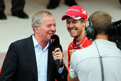 Martin Brundle, Sky Sports Commentator with Sebastian Vettel, Ferrari on the podium