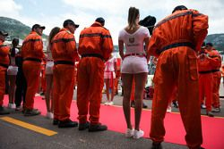 A grid girl and marshals on the drivers parade
