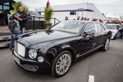 VIP service with a Bentley in the paddock