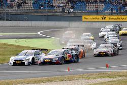 Start van de race, Miguel Molina, Audi Sport Team Abt Audi RS 5 DTM en Mattias Ekström, Audi Sport T