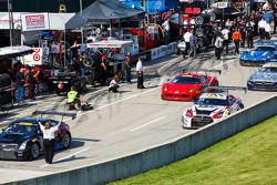 Cars leaving pit lane