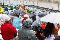 Fans wear rain gear in Detroit