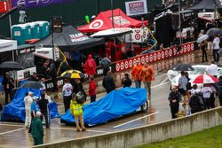 Covered cars during pre-race