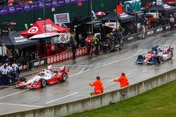 Cars pull off of pit lane