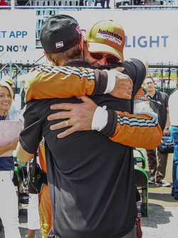 James Hinchcliffe is embraced by a member of the Holmatro Safety Team