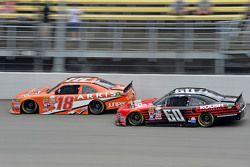 Daniel Suarez, Joe Gibbs Racing Toyota and Chris Buescher, Roush Fenway Racing Ford