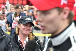 Sarah Fisher looks on as race winner Josef Newgarden, CFH Racing Chevrolet speaks to media