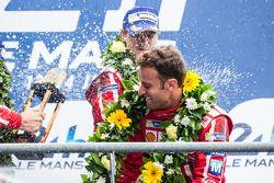LMP1 privateer podium: Rebellion Racing Mathias Beche celebrates with champagne