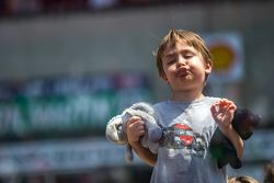 Young race fan on pit lane before the race