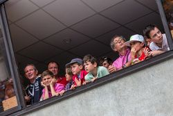 Young fans watching pitlane