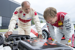 Hans-Joachim Stuck with Mattias Ekström celebrating a throwback livery celebrating Audi's debut DTM