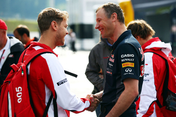 Sebastian Vettel, Ferrari with Ole Schack, Red Bull Racing Mechanic
