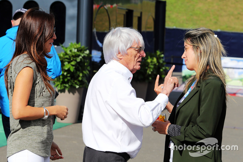 Fabiana Flosi, with husband Bernie Ecclestone, and Rafaela Bassi, wife of Felipe Massa, Williams