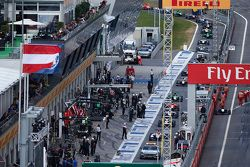 The safety car leads the field through the pit lane