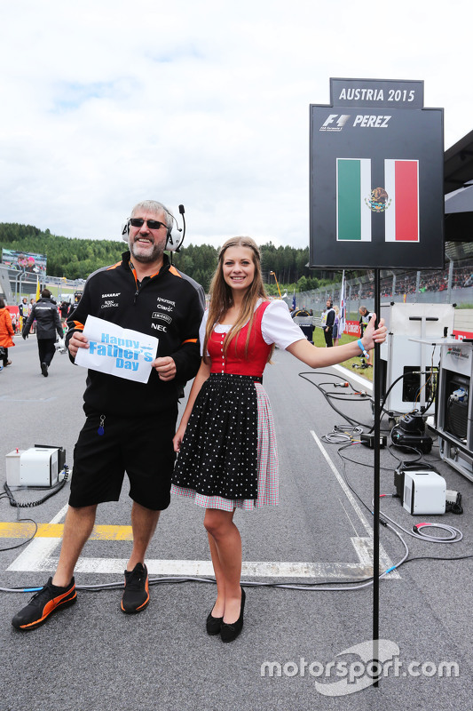 Grid girl for Sergio Perez, Sahara Force India F1 with a Sahara Force India F1 Team mechanic wishing a Happy Father's Day