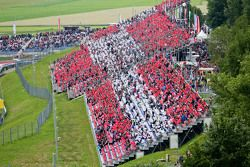 Fans in the grandstand recreate the Austrian flag