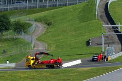 The Ferrari SF15-T oaf Antonio Fuoco, Ferrari Test Driver is recovered back to the pits on the back