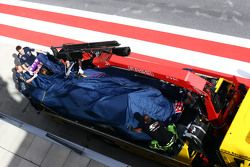 The Red Bull Racing RB11 of Daniel Ricciardo, Red Bull Racing is recovered back to the pits on the back of a truck