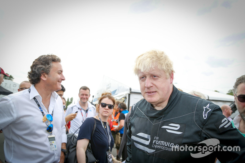 London Mayor Boris Johnson samples a Formula E car on the Battersea Park circuit