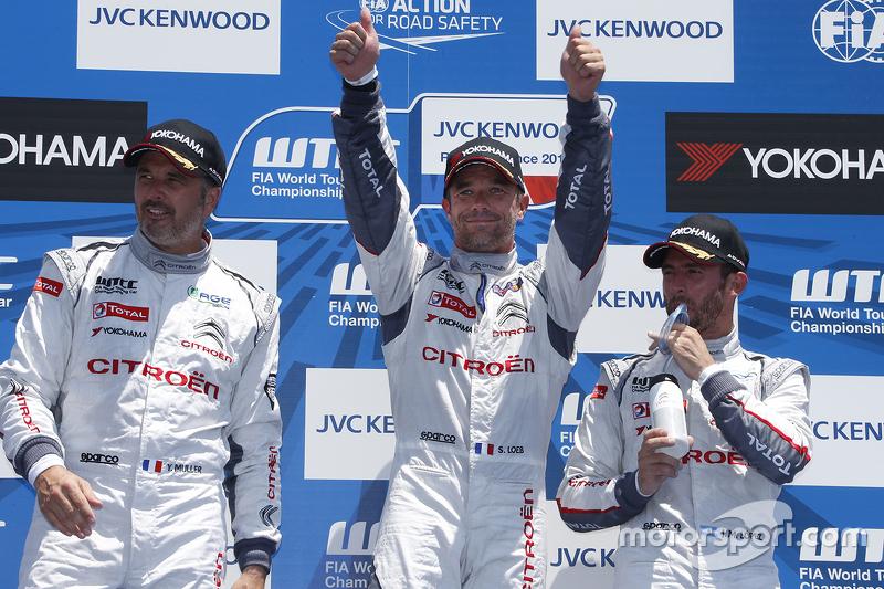 Podium: winner Sébastien Loeb, second place Yvan Muller, third place Jose Maria Lopez
