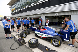 The Carlin team practice pitstops in the pit lane as Jann Mardenborough, Carlin watches