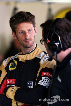 Romain Grosjean, Lotus F1 Team con Julien Simon-Chautemps, Lotus F1 Team Race Engineer