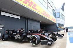 The McLaren MP4-30s of Fernando Alonso, McLaren and Jenson Button, McLaren