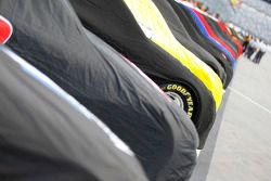 Cars covered on pit lane