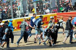 Fans invade the circuit at the end of the race.