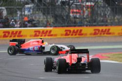 Roberto Merhi, Manor F1 Team spins in front of team mate Will Stevens, Manor F1 Team