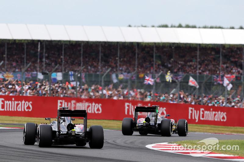 Fernando Alonso, McLaren MP4-30 leads Jenson Button, McLaren MP4-30 on the formation lap