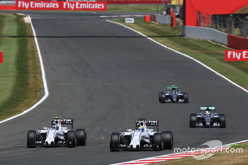 Felipe Massa, Williams FW37 and team mate Valtteri Bottas, Williams FW37 battle for position