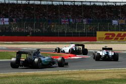 Felipe Massa, Williams FW37 leads the race from Valtteri Bottas, Williams FW37 and Lewis Hamilton, Mercedes AMG F1 W06