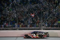 Austin Dillon, Richard Childress Racing Chevrolet and a confederate flag in the stands