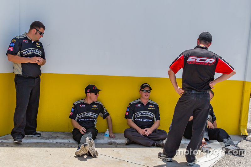 Team members enjoy the shade