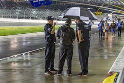 Crew members in the rain