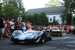 Race cars return to the track after the concours 1965 Lola T70
